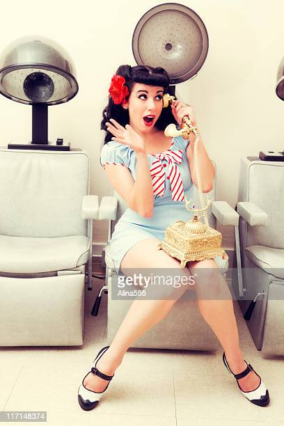 Pin-up: sexy woman in a beauty salon on the phone