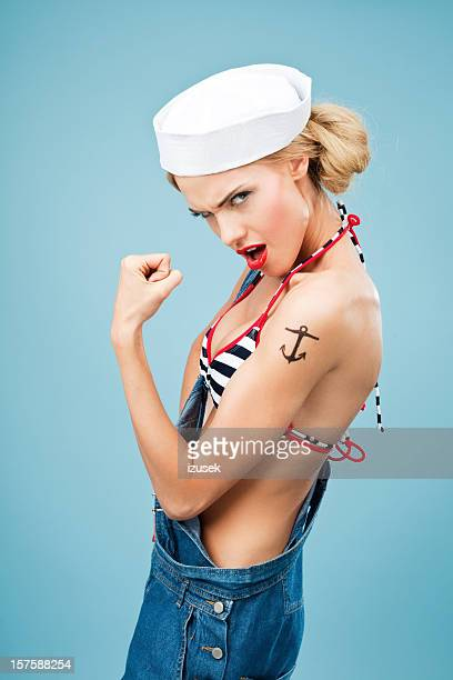 Pin-up style sailor woman flexing her arm