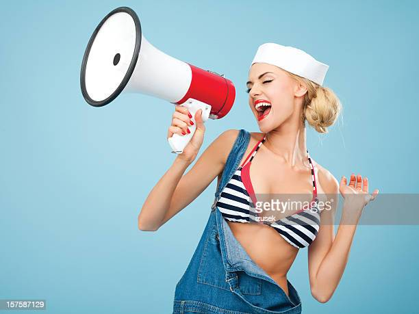 Pin-up style sailor woman shouting into megaphone