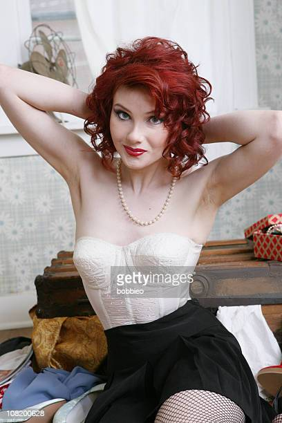 Pin-Up Style Woman Putting Pearl Necklace On