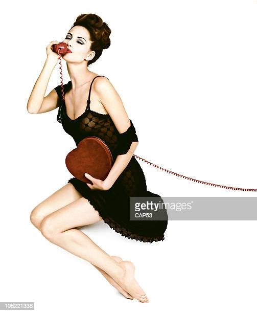 Pin-Up Style Young Woman Talking on Telephone