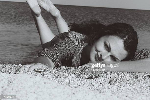 Pin-up.On a sand