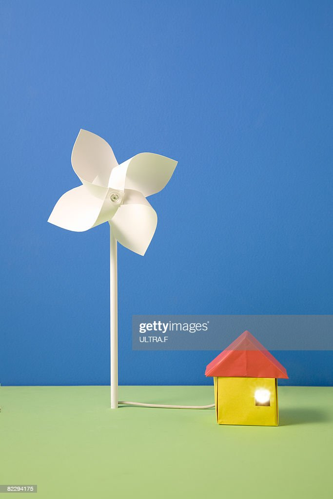 Pinwheel and house made out of paper : Stockfoto