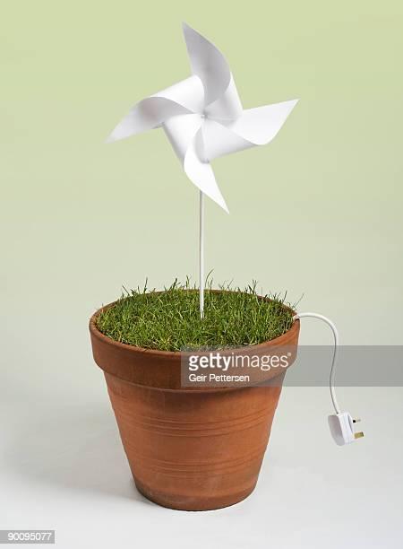 Pinwheel windmill in flowerpot with electric plug
