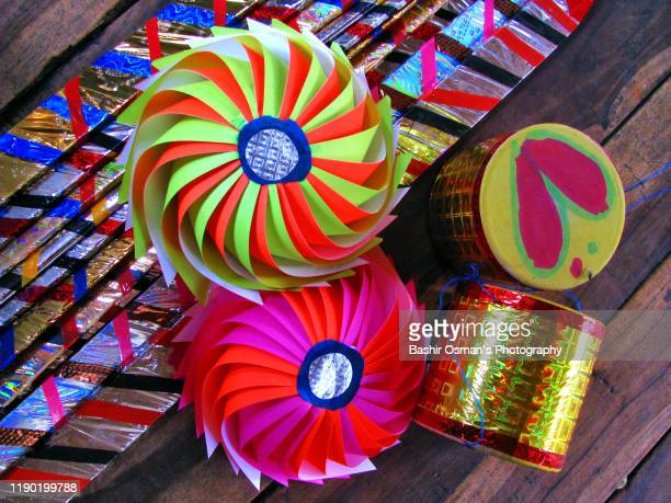 pinwheels and other handmade toys - may day international workers day stock pictures, royalty-free photos & images