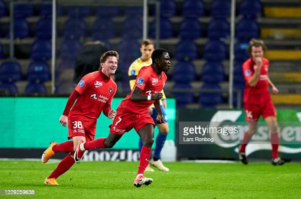Pione Sisto and Anders Dreyer of FC Midtjylland celebrate after scoring their second goal during the Danish 3F Superliga match between Brondby IF and...