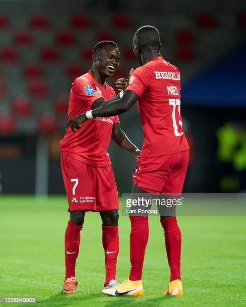 Pione Sisto and Awer Mabil of FC Midtjylland celebrate after scoring their third goal during the UEFA Champions League qual. Match between FC...
