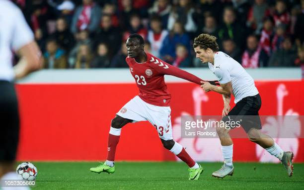 Pione Sisto of Denmark and Marcel Sabitzer of Austria compete for the ball during the international friendly match between Denmark and Austria at MCH...