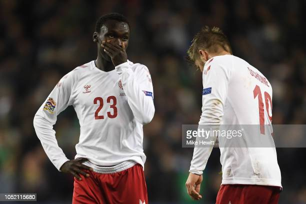 Pione Sisto of Denmark covers his mouth as he talks to team mate Lasse Schone during the UEFA Nations League B Group Four match between Ireland and...