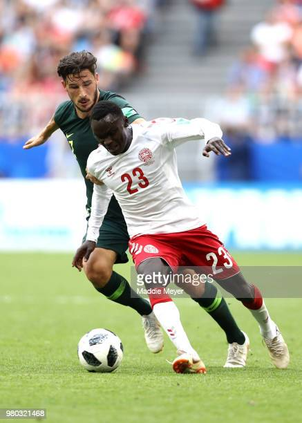 Pione Sisto of Denmark is challenged by Mathew Leckie of Australia during the 2018 FIFA World Cup Russia group C match between Denmark and Australia...