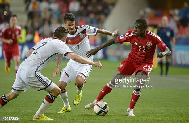 Pione Sisto of Denmark with Julian Korb and Leonardo Bittencourt of Germany during the UEFA European Under21 Group A match between Germany and...