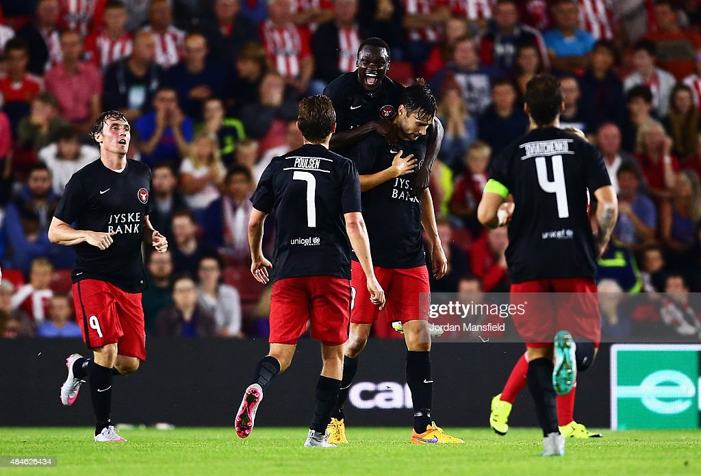 Pione Sisto of Midtjylland celebrates with goalscorer Tim Sparv after the opening goal during the UEFA Europa League Play Off Round 1st Leg match between Southampton and Midtjylland at St Mary's Stadium on August 20, 2015 in Southampton, England.
