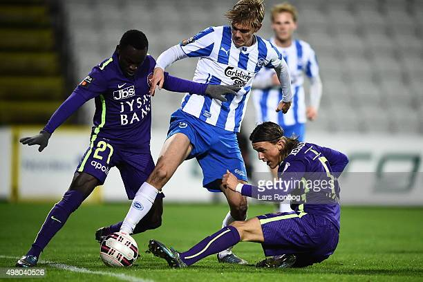 Pione Sisto of Midtjylland Mathias Greve of OB Odense and Kristoffer Olsson of Midtjylland compete for the ball during the Danish Alka Superliga...