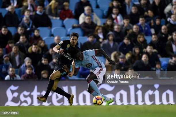 Pione Sisto of RC Celta de Vigo competes for the ball with Achraf Hakimi of Real Madrid during the La Liga match between RC Celta de Vigo and Real...