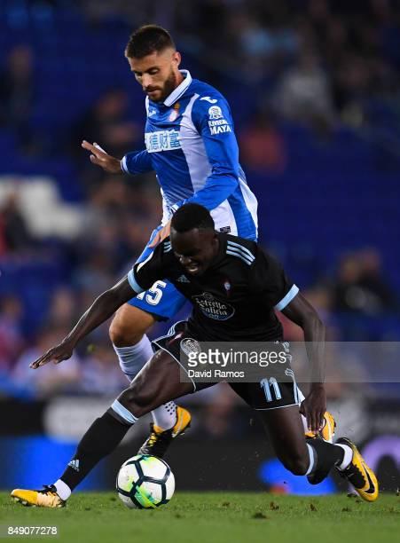 Pione Sisto of RC Celta de Vigo competes for the ball with David Lopez of RCD Espanyol during the La Liga match between Espanyol and Celta de Vigo at...