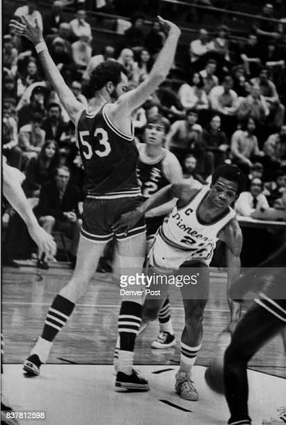 Pioneer captain slips past Indian defender En route to basket Denver's Joe Wallace drives past Southern Colorado's Denver University Basketball...