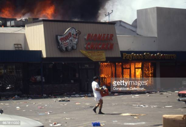 Pioneer Chicken and Payless Shoe Source on fire on Vermont Ave during widespread riots that erupted after the acquittal of 4 LAPD officers in the...