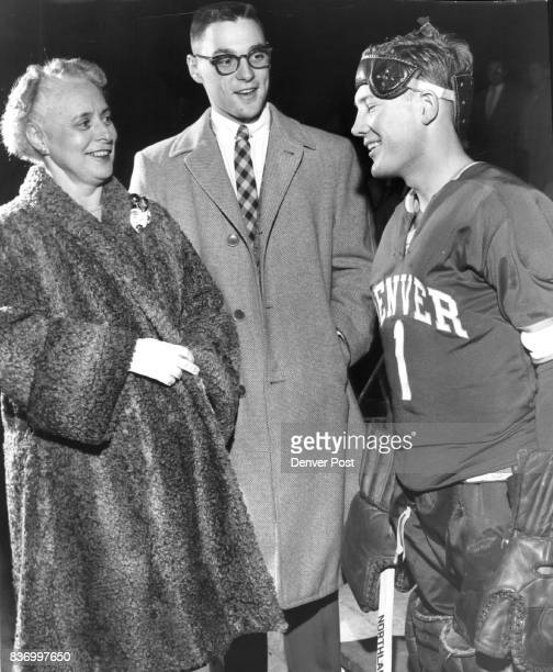 Pioneer GoalieRodney Schneck receives pregame well wishes from Mrs Chester M Alter wife of Denver University's chancellor and her son Dick a south...