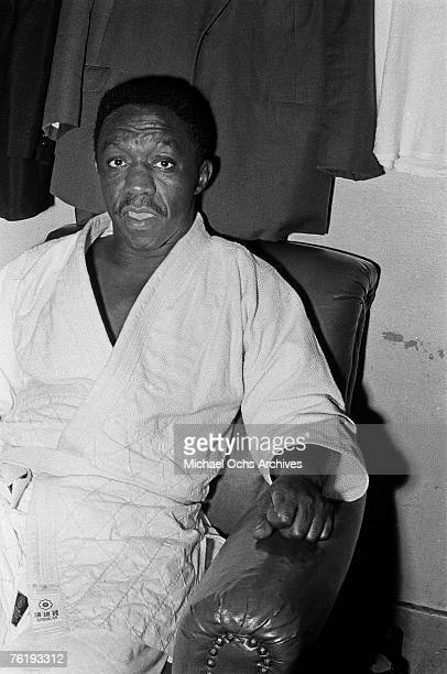 Pioneering jazz drummer Art Blakey relaxes backstage circa mid1964 at the Apollo Theater in Harlem New York