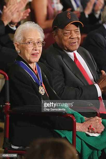 Pioneering NASA mathematician Katherine Johnson and Baseball Hall of Famer Willie Mays are presented with the Presidential Medal of Freedom during a...