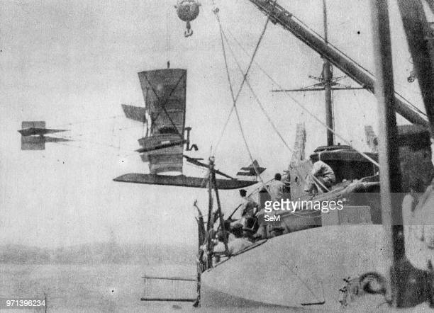 Pioneers of Italian aviation Seaplanes in service on the Ships are hoisted on board In the photo the recovery of a 'Curtiss'