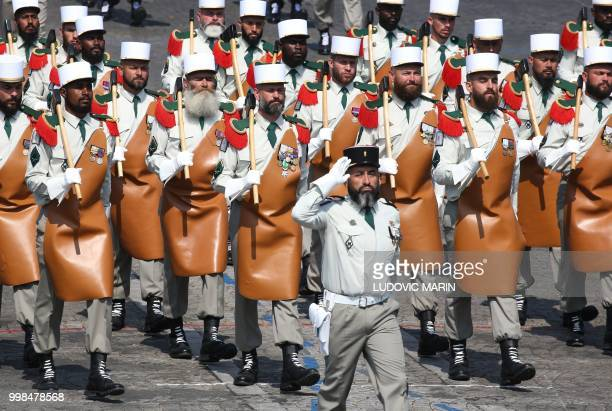 TOPSHOT Pionniers de la Legion Etrangere march during the annual Bastille Day military parade on the ChampsElysees avenue in Paris on July 14 2018