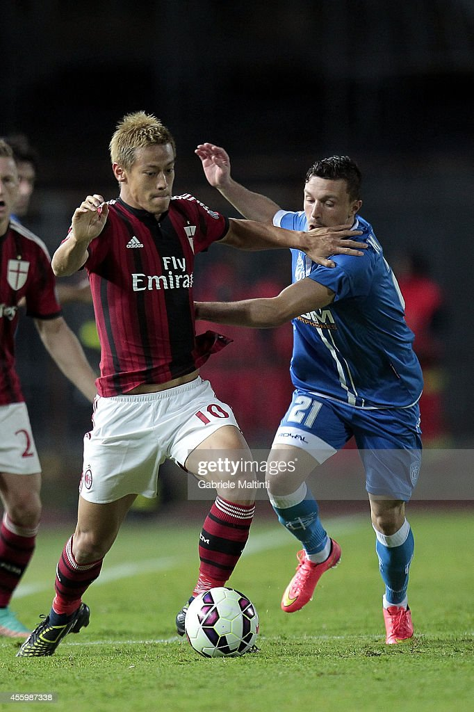 Pior Zielinski of Empoli Fc battles for the ball with Keisuke Honda of AC Milan during the Serie A match between Empoli FC and AC Milan at Stadio Carlo Castellani on September 23, 2014 in Empoli, Italy.