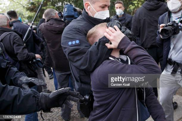 Piot police arrest a participant of a gathering of coronavirus skeptics during the third wave of the coronavirus pandemic on May 1, 2021 in Berlin,...