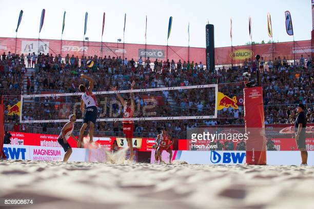 Piotr Kantor and Bartosz Losiak of Poland competes against Clemens Doppler and Alexander Horst of Austria during Day 9 of the FIVB Beach Volleyball...
