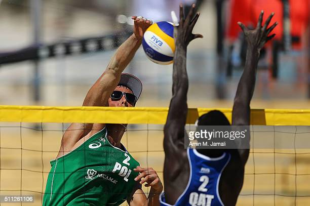 Piotr Kantor of Poland in action during the FIVB Kish Island Open match between Cherif Younousse and Jefferson Santos Pereira of Qatar and Piotr...