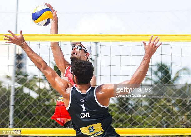 Piotr Kantor of Poland spikes the ball against Marco Grimalt of Chile during the main draw match at Pajucara beach during day four of the FIVB Beach...