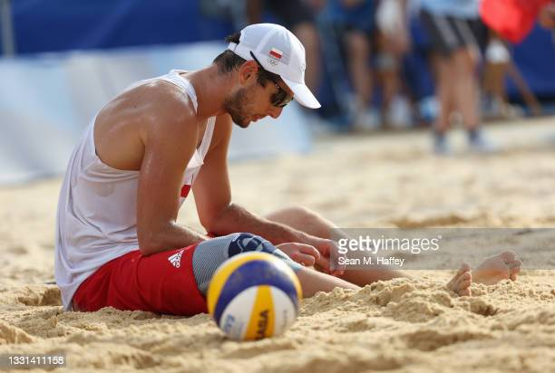 Piotr Kantor of Team Poland reacts as he competes against Team Italy during the Men's Preliminary - Pool F beach volleyball on day seven of the Tokyo...