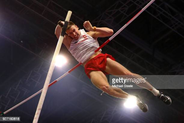 Piotr Lisek of Poland competes in the Men's Pole Vault Final during the IAAF World Indoor Championships on Day Four at Arena Birmingham on March 4...