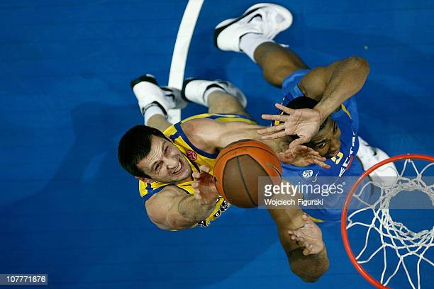 Piotr Szczotka of Asseco Prokom Gdynia competes with Richard Hendrix of Maccabi Electra Tel Aviv in action during the 20102011 Turkish Airlines...