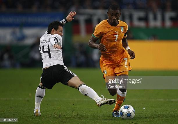 Piotr Trochowski of Germany challenges Salomon Kalou of Ivory Coast during the international friendly match between Germany and Ivory Coast at the...