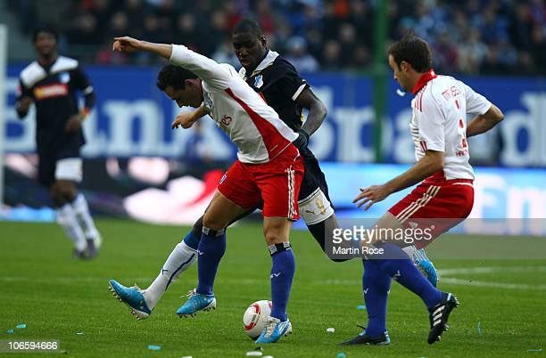 Piotr Trochowski of Hamburg and Demba Ba of Hoffenheim compete for the ball during the Bundesliga match between Hamburger SV and 1899 Hoffenheim at...