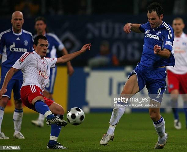 Piotr Trochowski of Hamburg challenges Heiko Westermann of Schalke for the ball during the Bundesliga match between Hamburger SV and FC Schalke 04 at...