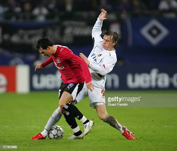 Piotr Trochowski of Hamburger SV is challenged by Ivica Olica of Moscow during the UEFA Champions League Group G match between Hamburger SV and CSKA...