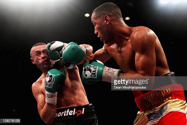 Piotr Wilczewski of Poland is hit by James DeGale of England during the European SuperMiddleweight Championship held at Liverpool Echo Arena on...