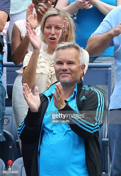 Piotr Wozniacki father and coach of Caroline Wozniacki of Denmark and Anna Wozniacki her mother celebrate her victory on Day 7 of the 2014 US Open at...