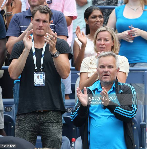 Piotr Wozniacki father and coach of Caroline Wozniacki of Denmark her mother Anna Wozniacki and her brother Patrick Wozniacki celebrate her victory...