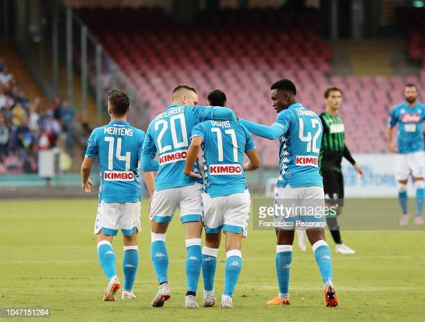 Piotr Zielinski Amadou Diawara and Adam Ounas of SSC Napoli celebrate the 10 goal scored by Adam Ounas during the Serie A match between SSC Napoli...