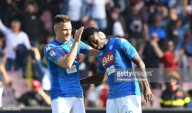 Piotr Zielinski and Amadou Diawara of SSC Napoli celebrate the 21 goal scored by Amadou Diawara during the serie A match between SSC Napoli and AC...