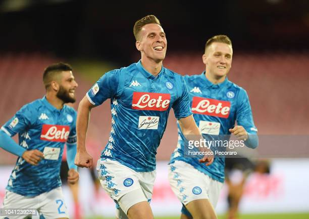 Piotr Zielinski and Arkadiusz Milik celebrate the 20 goal scored by Arkadiusz Milik during the serie A match between SSC Napoli and Parma Calcio at...