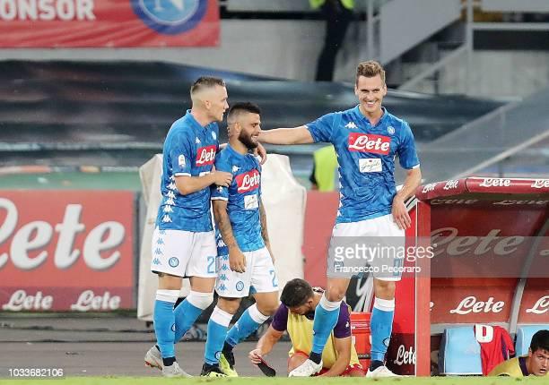 Piotr Zielinski Arkadiusz Milik and Lorenzo Insigne of SSC Napoli celebrate the 10 goal scored by Lorenzo Insigne during the serie A match between...