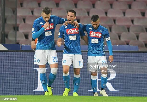 Piotr Zielinski, Lorenzo Insigne and Dries Mertens of SSC Napoli celebrate the 2-0 goal scored by Dries Mertens during the Serie A match between SSC...