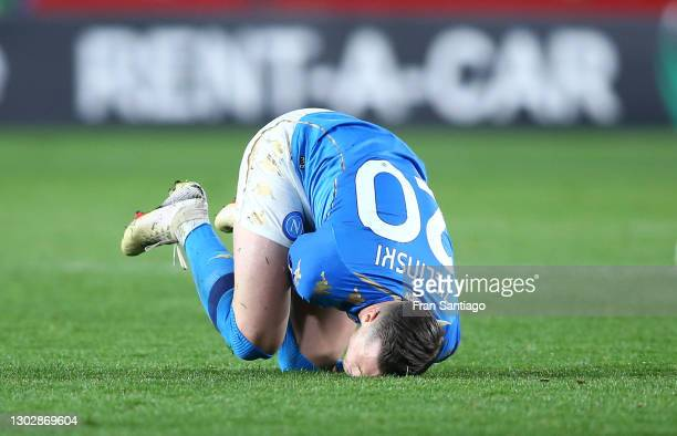Piotr Zielinski of Napoli goes down injured during the UEFA Europa League Round of 32 match between Granada CF and SSC Napoli at Nuevo Estadio Los...