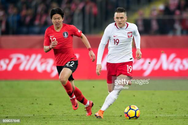 Piotr Zielinski of Poland and Chang-hoon Kwon of Korea during the international friendly match between Poland and South Korea at Silesian Stadium in...