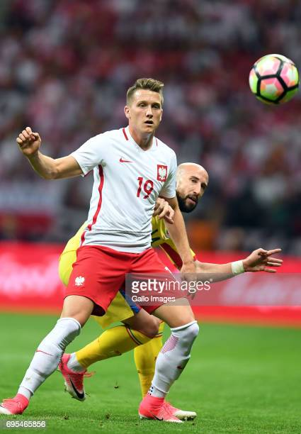 Piotr Zielinski of Poland and Iasmin Latovlevici of Romania in action during the 2018 FIFA World Cup Russia eliminations match between Poland and...