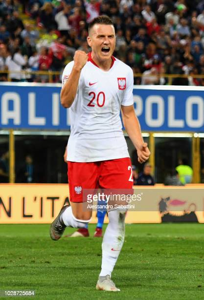 Piotr Zielinski of Poland celebrates after scoring the opening goal during the UEFA Nations League A group three match between Italy and Poland at...